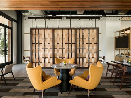 Weft & Warp Art Bar + Kitchen's room divider represents