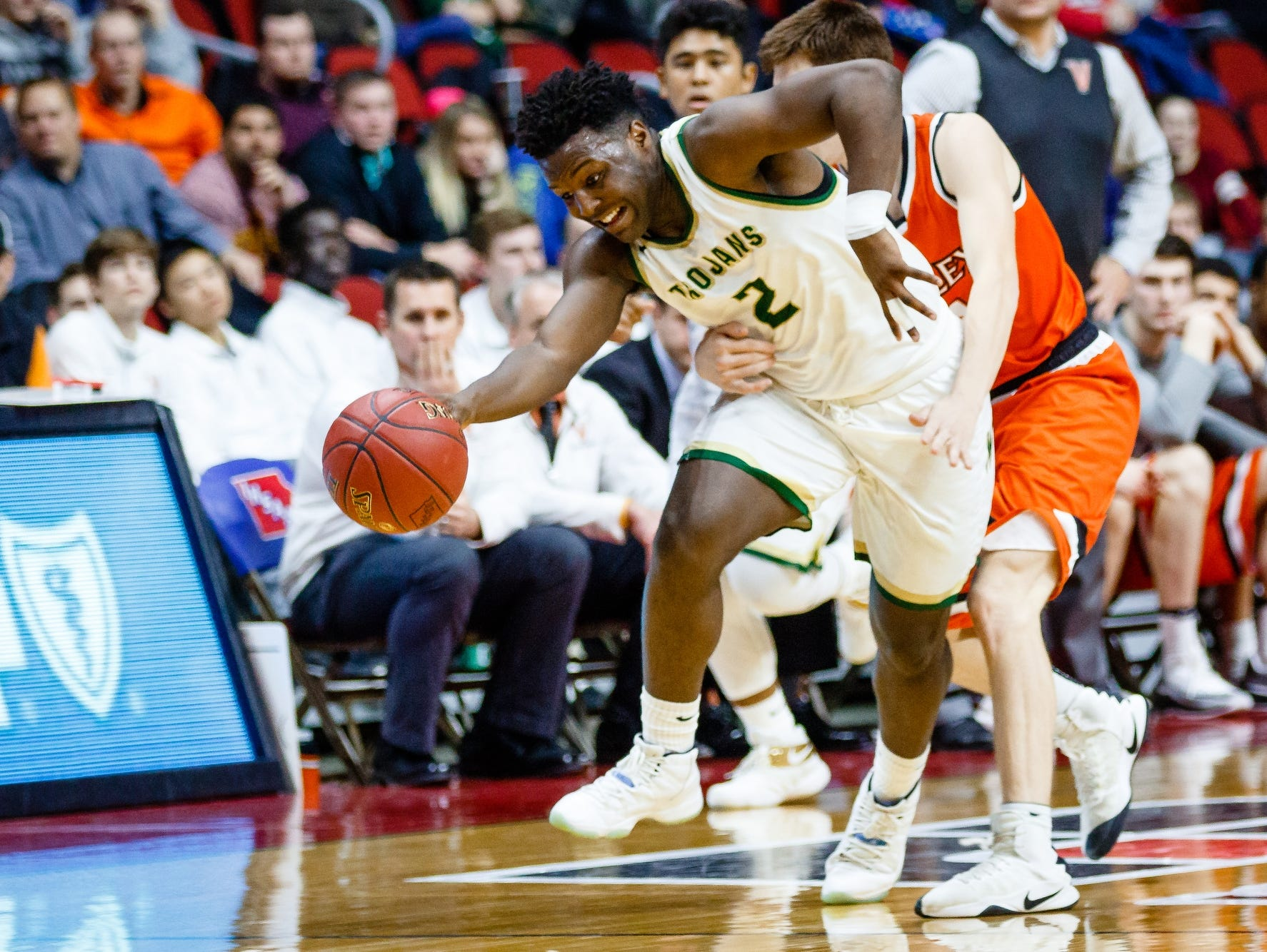 Iowa City West's Devontae Lane (2) is fouled by Valley's Reese Skinner (12) during their 4A state basketball championship game on Saturday, March 11, 2017, in Des Moines. Iowa City West would go on to win 64-50