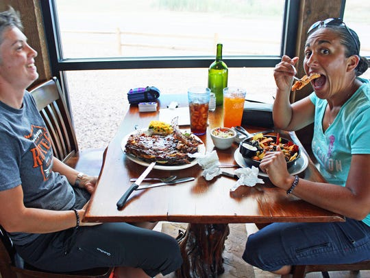 Route 66 travelers enjoy a meal at Lulu Belle's in