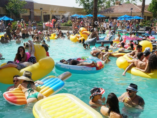 People float in the Renaissance Hotel pool during Splash