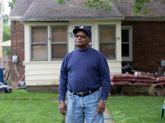 Carl Baxter poses for a portrait in the backyard of his home on Friday, May 19, 2017 in the Crary St. Mary neighborhood in Detroit. Baxter, a retired phone company worker and union official heads the local Crary St. Mary's Community Council.
