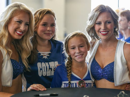 From left, Indianapolis Colts cheerleader Sammy, Olivia