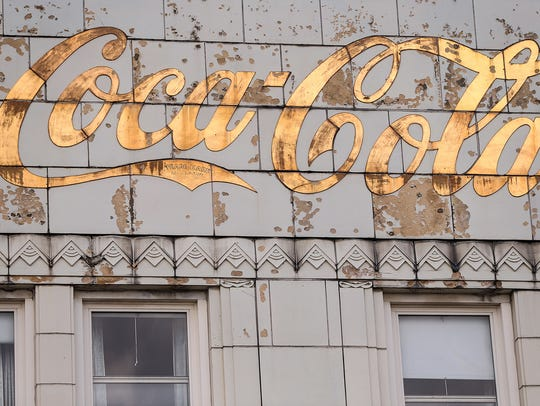 A worn Coca-Cola logo, as seen during a media tour