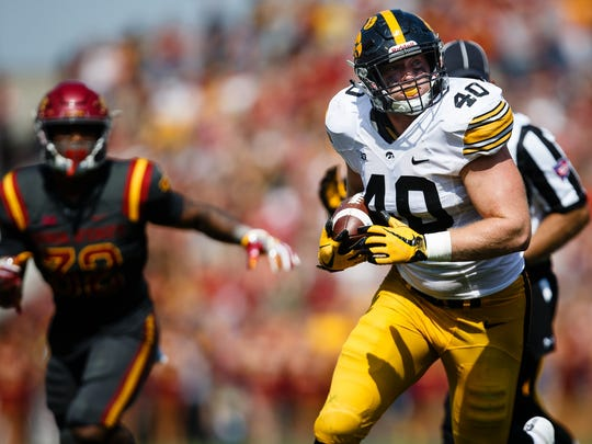 Iowa junior defensive lineman Parker Hesse (40) runs the ball after an interception during the second half of the Cy-Hawk football game at Jack Trice Stadium on Saturday, Sept. 9, 2017, in Ames.