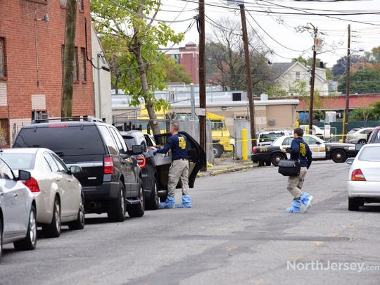 The FBI remove's evidence from the suspect's apartment at apartment at 168 Genessee Ave in Paterson on Wednesday, Nov. 1, 2017.