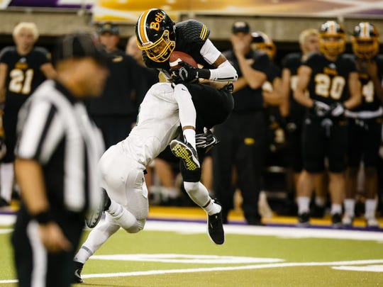 Bettendorf's Darien Porter (23) catches a pass during their 4A state semi-final football game against Iowa City, West at the UNI Dome on Friday, Nov. 10, 2017, in Cedar Falls.