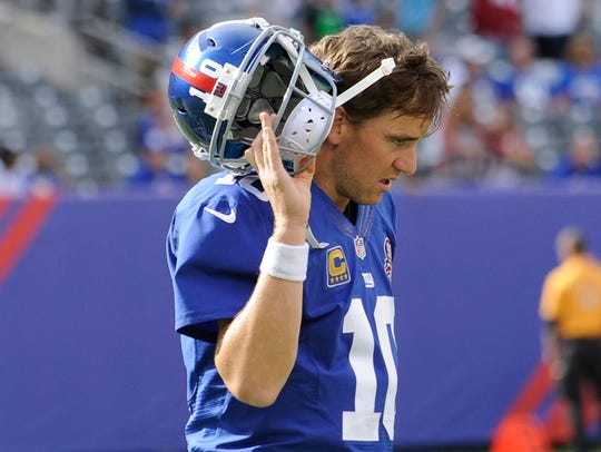 Giants' Eli Manning after throwing an interception