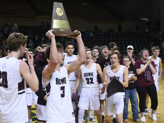 Bowie's Keck Jones lifts the trophy after a win against