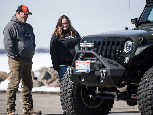 Jeep enthusiasts Stewart Allison of Bonduel, and Kim Rowley of Sheboygan talk Sunday, March 11, 2018 in Lakeside Park in Fond du Lac during a meeting of Wisconsin Jeep Owners. A group of jeep owners that meet and do activities together. Doug Raflik/USA TODAY NETWORK-Wisconsin