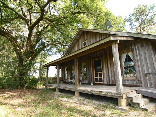 The Hyatt at Swallowfork Lake and Cabins is over 80 years old and sits under a large live oak.
