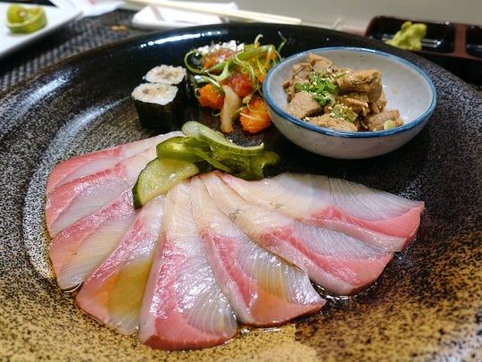 Sashimi at Sushi Nakano in Phoenix. (Clockwise from foreground: Yellowtail with pickled cucumber and jalapeño, aji maki, poke, tuna kakuni.)