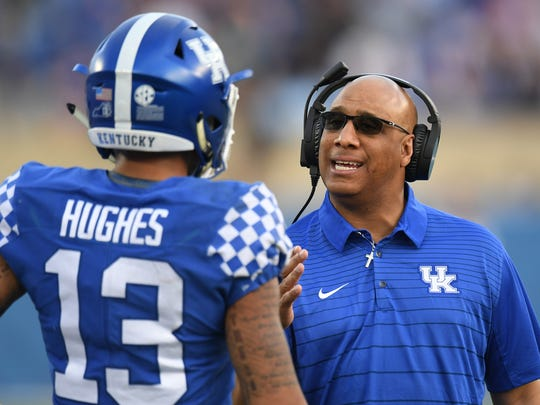 UK wide receiver coach Michael Smith talks to Zy'Aire Hughes during the 2018 spring game.