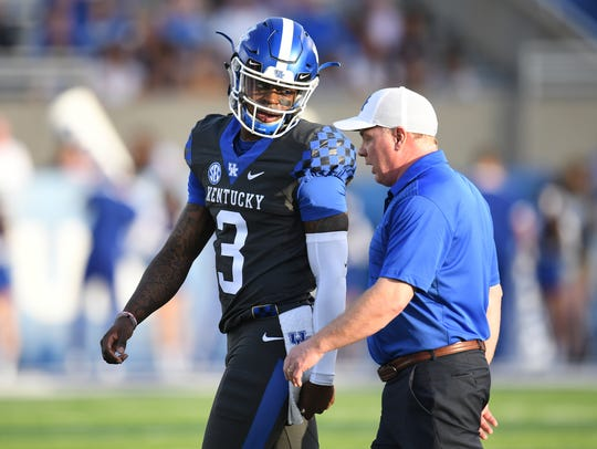 Terry Wilson talks with Mark Stoops during UK's 2018 spring game in April.