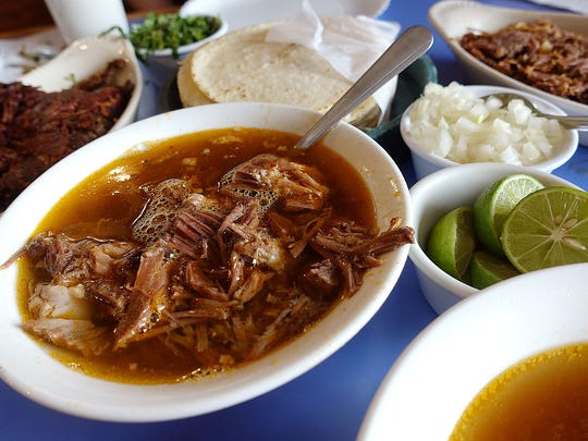 Birria de chivo (roasted goat) in consomme at Hola