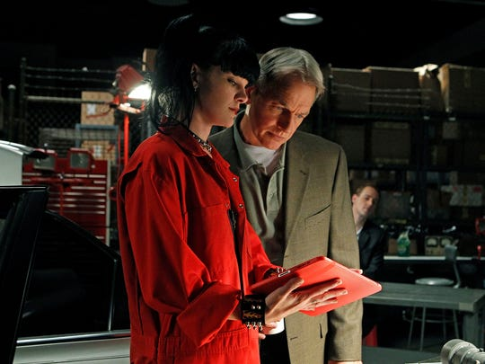 Abby (Pauley Perrette) shares information with NCIS boss Gibbs (Mark Harmon) in a 2010 episode.