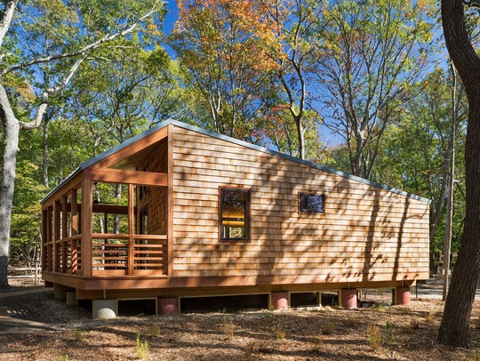 A cabin by WXY Architechs in the Woods of Wildwood