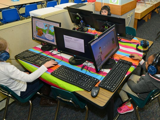 Students work on the computer at NSU Elementary Lab,