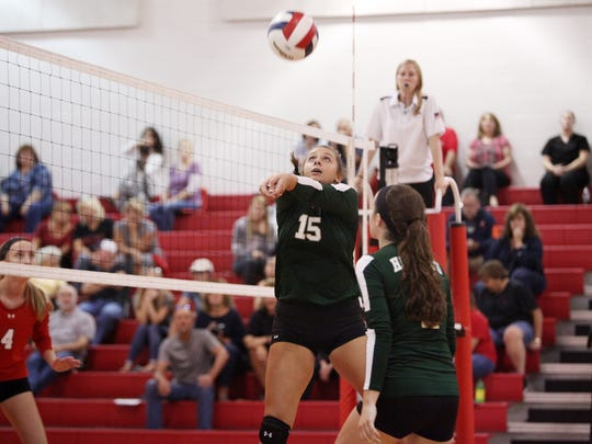 Wilson Memorial's Madison Crist bumps the ball to team mate Emma Nargi at Riverheads High School on Tuesday, Sept. 27, 2016.