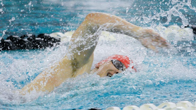 Waukesha South / Catholic Memorial junior John Acevedo competes in the 200-yard freestyle at the Greater 8 Conference swimming and diving championships Jan. 28.