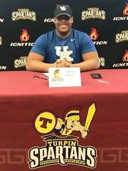 Turpin High School football's Quinton Wilson signed his national letter of intent to play for the University of Kentucky Dec. 20, 2017, at Turpin