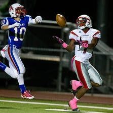 Chaparral High School's Tyler Whiley makes a catch over Arcadia's High School's Edward Rodriguez during Friday's high school football game. He ran the ball in for a touchdown.