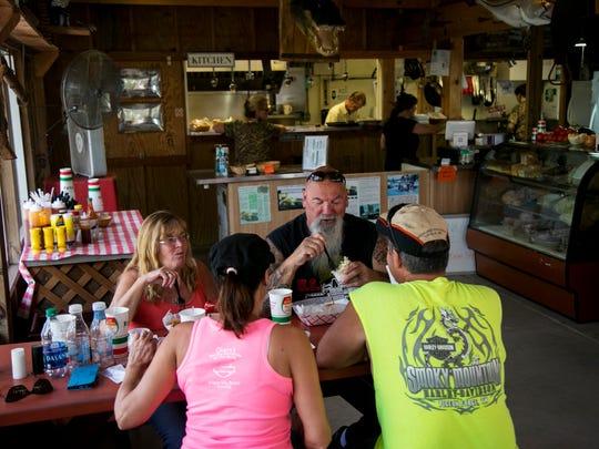 Friends eat together at the Gator Shack at Babcock