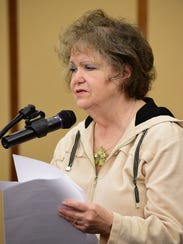 Sharon Eastman of Redford reads her poem, 'I am not