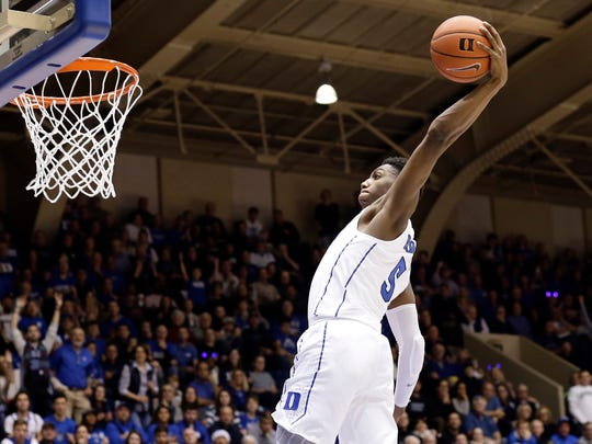 Duke's RJ Barrett drives for a dunk against Yale during the second half of an NCAA college basketball game in Durham, N.C., Saturday, Dec. 8, 2018