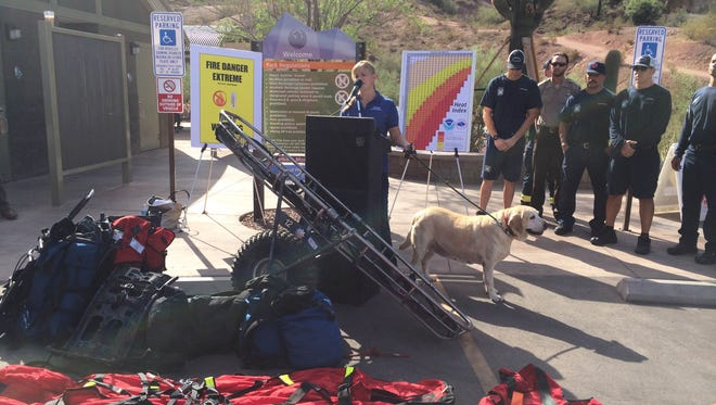 Bretta Nelson of the Arizona Humane Society speaks with the media about the dangers that hiking in the heat can pose to pets and people.