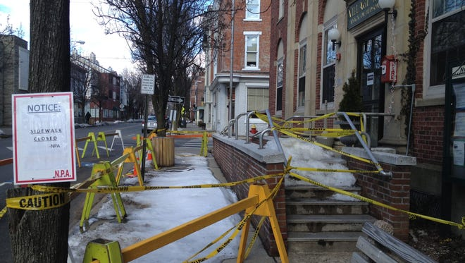 The sidewalk and stairs in front of Nyack Village Hall are closed indefinitely because a brick wall in between them is in danger of collapsing. People can enter the building, seen here on Feb. 24, 2014, by the ramp on the other side of the stairs.
