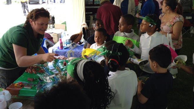 Children learn about wetlands at a DNREC exhibit in Rodney Square in Wilmington.