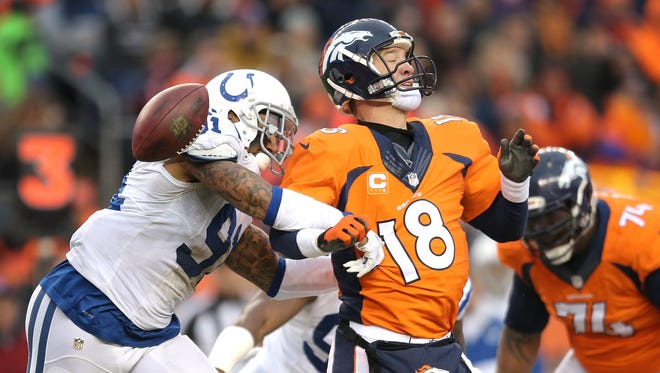 Indianapolis Colts linebacker Jonathan Newsome strips the ball from Denver Broncos quarterback Peyton Manning in the second quarter. Indianapolis faced Denver in the NFL playoffs Sunday, January 11, 2015.