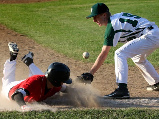 Sussex Hamilton's Brayden Gorecki slides in safe at