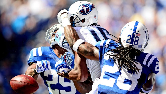 Colts safety Mike Adams (28) and corner Greg Toler keep Titans receiver Justin Hunter from making a catch in the second quarter Sunday.