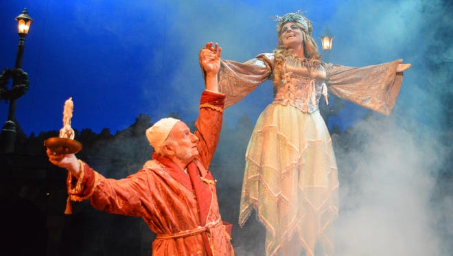 """Scrooge and the Ghost of Christmas Past are pictured in this file photo from the University of West Florida's production of """"A Christmas Carol."""" Catch this year's production at 7:30 p.m. Friday and Saturday and 2:30 p.m. Sunday."""