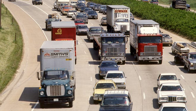 The heavy stream of midafternoon traffic on the 440 Parkway April 22, 1988 includes several trucks, a situation the state has gone to federal court to change. The state says they have the authority to ban trucks from the parkway, but the federal government and the trucking industry said since it was constructed with 90% federal funding, it is part of the federal interstate system and trucks are allowed. The traffic, near Nolensville Road, is heading west.