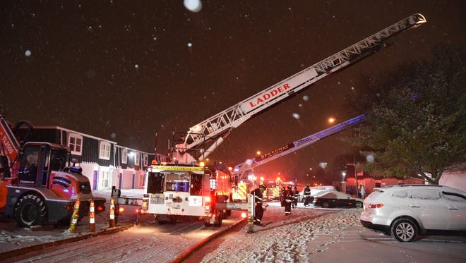Indianapolis firefighters respond to a fire at Villa Del Sol Apartments, 3507 N. Mission Drive, that forced the evacuation of 23 occupants on Friday, Dec. 29, 2017.