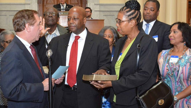 William W. Spearman, center, takes the oath office to become the state's newest assemblyman, representing the 5th Legislative District in South Jersey.