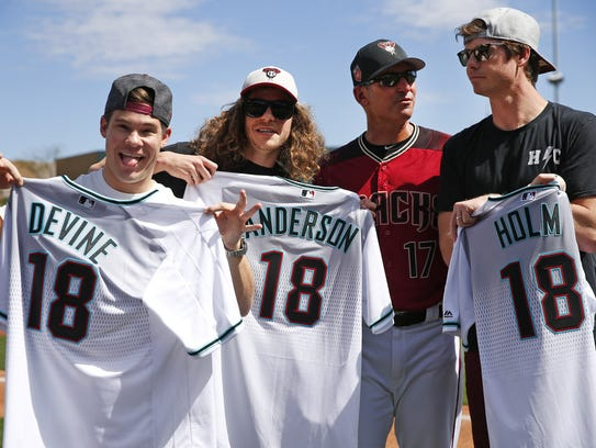 Actors Adam DeVine, Blake Anderson and Anders Holm pose with Arizona Diamondbacks manager Torey Lovullo before a spring training at Salt River Fields at Talking Stick on March 14, 2018.