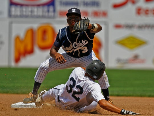 East Cobb Yankees' Xzavion Curry records an out against