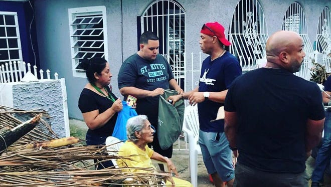 Hall of Famer Roberto Alomar visits his hometown of Salinas in Puerto Rico on Sunday, handing out water, food and t-shirts to help relief efforts caused by the destruction of Hurricane Maria.