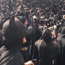 More than 500 Nexen Energy staff members dressed as Batman.