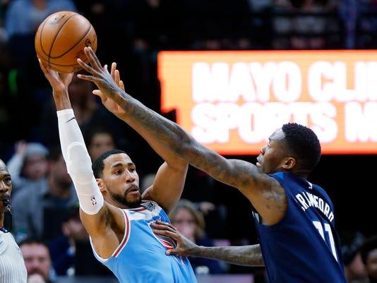 Minnesota Timberwolves Jamal Crawford (11) pressures Sacramento Kings guard Garrett Temple (17) in the second quarter of an NBA basketball game Sunday, Feb, 11, 2018 in Minneapolis. (AP Photo/Andy Clayton-King)