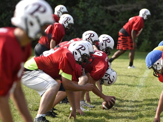 Pierz players line up to start a play during practice