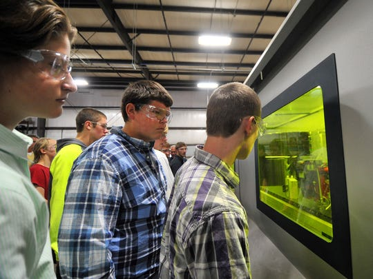 D.C. Everest High School students tour Applied Laser Technologies in Weston as part of their learning about entrepreneurship on Friday, Oct. 9, 2015.
