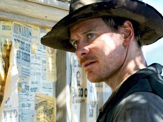 """Michael Fassbender portrays a mysterious bounty hunter who uses a clueless greenhorn to lead him to his prey in """"Slow West."""""""