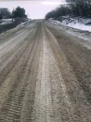 A gravel road stretches onward near Harry Pettit's house in Madison County. Pettit questions the amount the county spends on maintaining its gravel roads versus the amount it has agreed to spend on health insurance and a wellness program for more than 80 county employees.