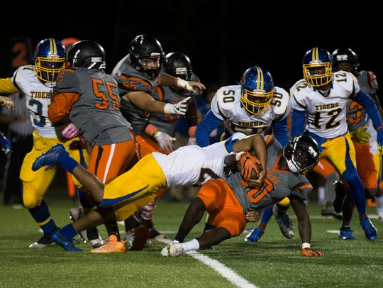 Lely's Henderson Francois (10) is brought down near