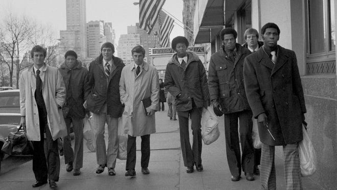 Members of the Indiana University basketball team, the Hoosiers, walk on 59th Street and Central Park South in New York City in 1975.
