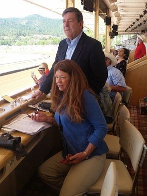 Calder and Candy Ezzell watch their horse Sister Sophia during practice training races at Ruidoso Downs Race Track Wednesday.